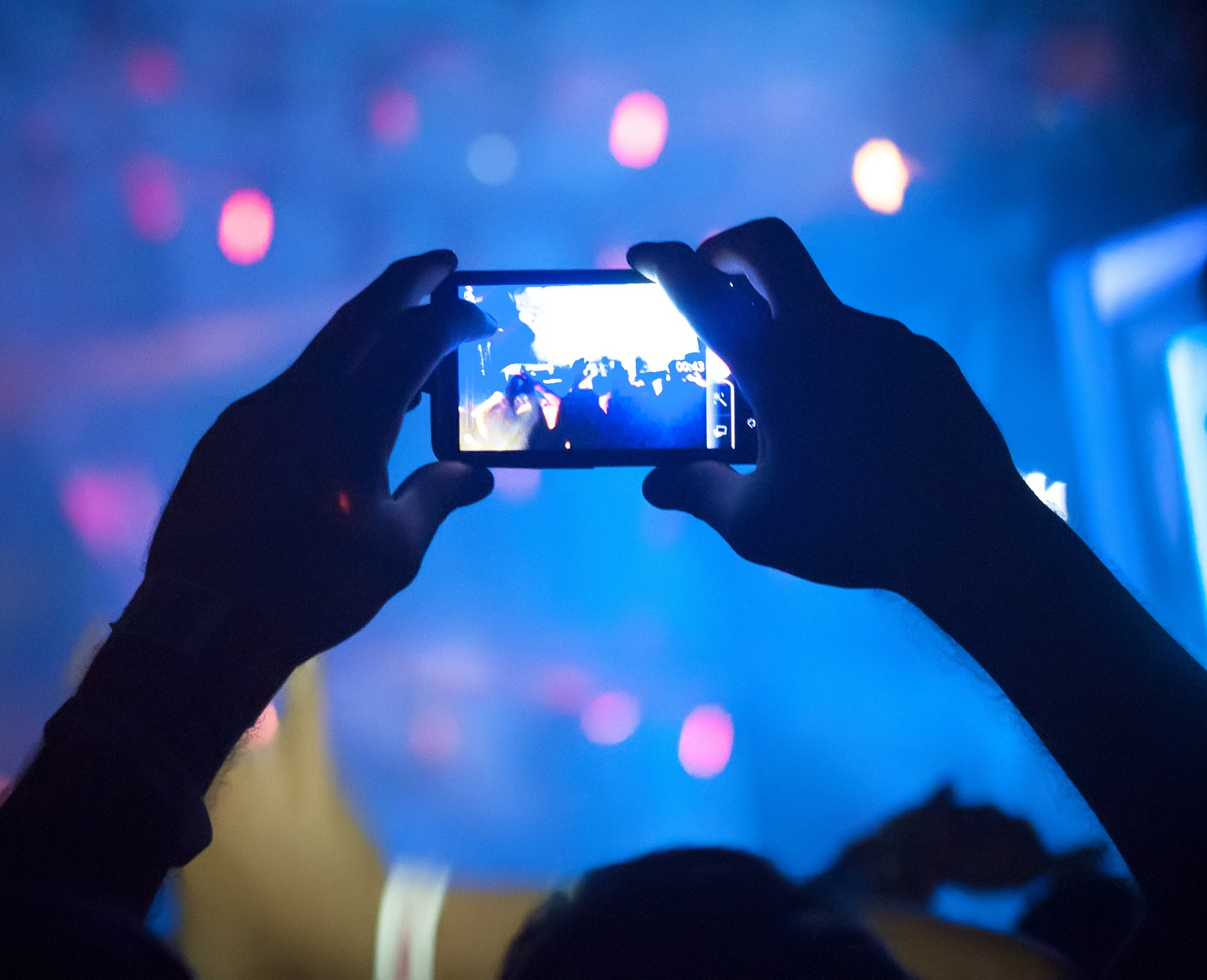 Crowd taking photos at a concert